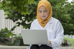 Healthcare, medical and radiology concept - pretty doctors looking at laptop Royalty Free Stock Photography