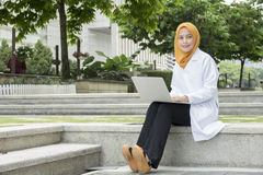 Healthcare, medical and radiology concept - pretty doctors looking at laptop Royalty Free Stock Image