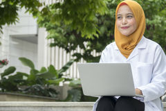 Healthcare, medical and radiology concept - pretty doctors looking at laptop Stock Images