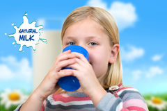 Healthcare and medicine concept - ill little girl with flu holding cup of hot tea or milk. Stock Photography
