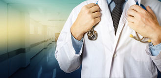 Healthcare and Medicine concept. Unrecognizable Male Doctor Holds Hands On Stethoscope Stock Images