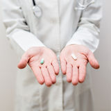 Healthcare and medicine. Doctors hand holding pills or capsules Stock Photos