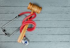 Healthcare and medicine. Malpractice law legal system gavel stethoscope Stock Photos