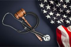 Healthcare and medicine. Malpractice law legal system gavel stethoscope vertical Stock Photo