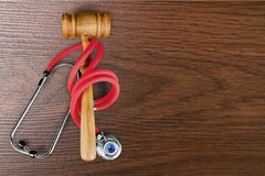 Healthcare And Medicine. Malpractice Law Legal System Gavel Stethoscope Vertical Royalty Free Stock Photo