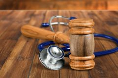 Healthcare And Medicine. Malpractice Legal System Stethoscope Gavel Insurance Failure royalty free stock photo