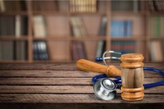 Healthcare And Medicine. Malpractice Legal System Stethoscope Gavel Insurance Failure royalty free stock images