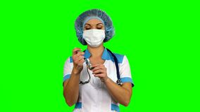 Healthcare and medicine: nurse using a syringe on stock video