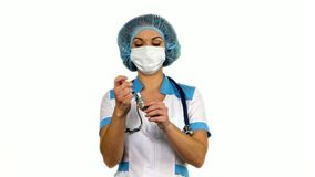 Healthcare and medicine: nurse using a syringe on stock footage