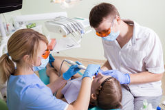 Healthcare, medicine. Young women with dentist in a dental surgery royalty free stock image