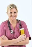 Healthcare - nurse holding pills Royalty Free Stock Photos