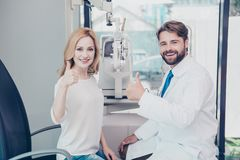 Healthcare, people, eyesight and vision concept. Smiling man opt royalty free stock photography