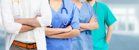 Doctor working in hospital with other doctors. Healthcare people group. Professional doctor working in hospital office or clinic with other doctors, nurse and royalty free stock photography