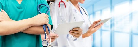 Doctor working in hospital with other doctors. Healthcare people group. Professional doctor working in hospital office or clinic with other doctors, nurse and royalty free stock images