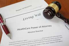 Power of Attorney. Healthcare Power of Attorney, Living Will and Power of Attorney documents with gavel stock photos