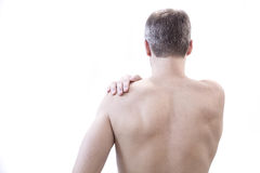 Healthcare and problem concept - unhappy man suffering from neck or shoulder pain at home Royalty Free Stock Images
