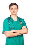 Healthcare, profession, people and medicine concept - smiling male doctor in white coat.  Stock Image
