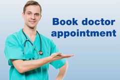 Healthcare, profession, symbols, people and medicine concept - smiling male doctor  in coat over blue background with Stock Photos