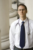 Healthcare Professional. A young attractive doctor outside his office during the workday Royalty Free Stock Images