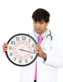 Healthcare professional or doctor or nurse holding up big clock Royalty Free Stock Photography