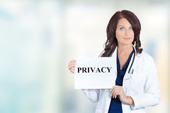 Healthcare professional doctor scientist holding privacy sign Royalty Free Stock Image