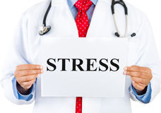 Healthcare professional holding up stress sign Stock Photo
