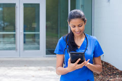 Healthcare professional reading tablet Stock Photo