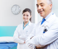 Healthcare professionals. Health care professionals with medical equipment in the background Stock Photos