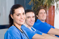 Healthcare staff. Group of young healthcare staff relaxing in hospital hallway during break stock photo