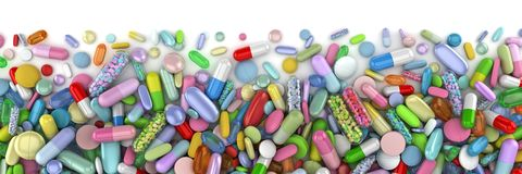 Healthcare themed pile of colorful pills stock photo
