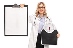 Healthcare woman holding a weight scale Royalty Free Stock Photo