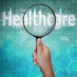 Healthcare, word in Magnifying glass royalty free stock images