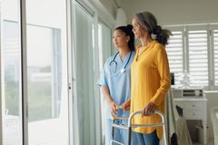 Free Healthcare Worker And Woman Using Walking Aid Stock Photo - 152802260