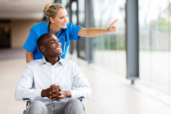 Healthcare worker disabled patient Stock Photo