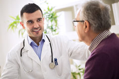 Healthcare worker and elderly patient stock photo