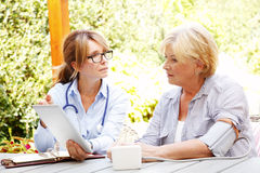 Healthcare worker and her patient Royalty Free Stock Image