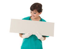 Healthcare worker woman with empty board Royalty Free Stock Image