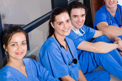 Healthcare workers. Group of healthcare worker relaxing in hospital hallway during break royalty free stock images