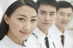 Healthcare workers standing in a row, China, Close-up Stock Images