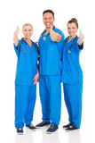 Healthcare workers thumbs up. Group of cheerful healthcare workers thumbs up Royalty Free Stock Photo