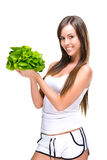 Healthful eating-Beautiful fit woman holding a salad Royalty Free Stock Images