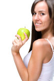 Healthful eating-Beautiful natural woman holds an apple Stock Photo