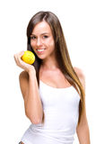 Healthful eating-a beautiful woman holding the oranges fotografia de stock royalty free