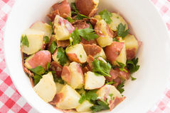 Healthful potato salad. Potato salad and healthy eating. Made with new potatoes, turkey bacon, parsley and olive oil Royalty Free Stock Photos