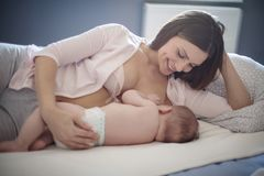 The healthiest baby food. Mother feeding her baby stock images