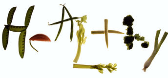 Healthy. Spelled out using vegetables (snow peas, tomatoe, green beans, celery, corn, broccoli and spring onions stock photos
