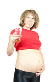 Healthy 7 months pregnant woman. Portrait of pregnant woman with glass of water, white background Royalty Free Stock Images