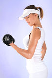 Healthy. Athletic young girl tilling dumbbell royalty free stock photos