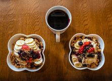 Healthy Acai berry bowls with fruit and granola and black coffee. Healthy superfood that`s tasty and refreshing royalty free stock image