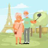 Healthy active lifestyle retiree. For grandparents. Elderly people characters travel. Voyage for grandparents family Seniors make a selfie on Eiffel tower view Royalty Free Stock Photo